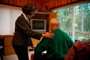 Marilyn instructing patient how to come to standing from sitting